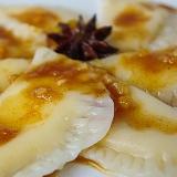 Pierogi z serem w sosie pomarańczowo-cynamonowym